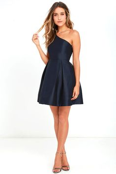 Our obsession with the Unconditional Love Navy Blue One Shoulder Skater Dress knows no bounds! Flattering princess seams lay below a rounded one shoulder neckline and open back, while a full skater skirt flares from a fitted waist. Hidden side zipper with clasp.