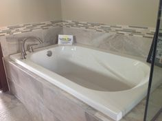 Drop-in tub with gray tile