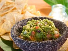 Crunchy salty tortilla chips and creamy guacamole are impressive when they're freshly made at home.