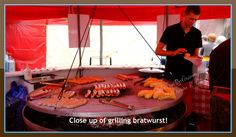 Bratwurst grilling at German booth.