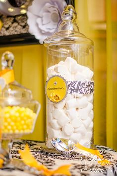 Candy jars at a damask and yellow birthday party! See more party ideas at CatchMyParty.com!