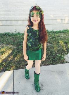 Alexis: My daughter is posing as Poison Ivy from Batman. This whole Costume was made by me at home for under $40.00!.