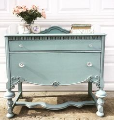 """What an amazing shabby antique 1920s mid size buffet! Such a rare size and perfect for anyone who loves those big buffets but doesn't have the room! In perfect condition, solid and heavy, spotless and clean. Two good size drawers. Hand painted in my favorite Persian Blue/ Antique White Milk Paint mix, tastefully distressed and clear satin waxed."" - Shabby Accent Living"