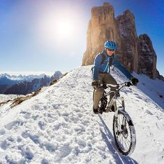 Photo of the Day! While most climb to the famous rock formation of the Tre Cime di Lavaredo, @coberschneider takes it up a notch. #GoProSnow #Dolomites