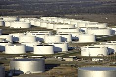 Oil storage tanks in Cushing, Oklahoma, U.S. Despite initial gains earlier in the week, oil prices are heading downwards in what some analysts interpreted as a shift in sentiment.