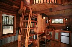 This is a tiny house. Brilliant to incorporate the ladder with the shelves. -- i love the idea of compact living with well designed use of space. (so much easier to clean and much cheaper to heat/cool, decorate)