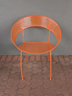this colorful metal chair in powder coated tangerine orange brings spunk + hue anywhere you place it. perforated holes + its round shape add visual texture; we love these chairs around a dining table, in front of a desk or on the back patio. pair with its matching sunshine table for striking appeal.