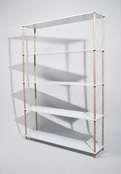 Wired Shelfis a minimalist design created by France-based designerSiyuan Zhang. The shelf was designed to be assembled without the use of screws or nails. The entire structure is held together by elastic metal wires that provide tension and keep the assembly together.
