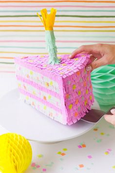 Add a birthday cake piñata to your party.