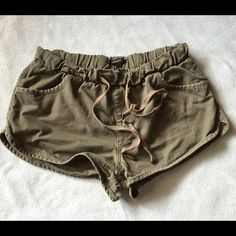 Forever 21 Army Green Shorts Adorable shorts from Forever 21. Army green with an elastic waistband and drawstring. Size medium. 2 inch inseam. No known flaws. Forever 21 Shorts