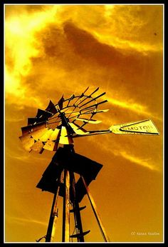 windmill against an orange sky Windmill Decor, Old Windmills, Wind Of Change, Old Fences, Autumn Scenes, People Of Interest, Ranch Life, Water Tower, Farm Life