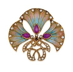 Art Nouveau. Ruby, Diamond and Enamel Brooch, circa 1895. Designed as three plique-a-jour enamel flowers by virgie