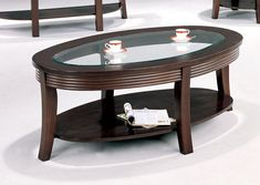 Transitional style oval shaped, occasional table in cappuccino finish with tempered glass top and additional storage shelf. Coaster Furniture, Table Furniture, Living Room Furniture, Discount Furniture Stores, Online Furniture, European Furniture, Contemporary Furniture, Round Seat Cushions, Space Saving Furniture