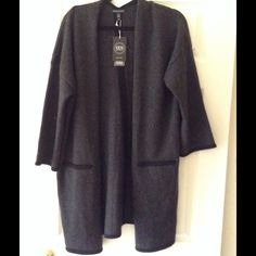 New! Eileen Fisher V-BK 3/4 sleeve Cardigan Fine Gauge 100% Cashmere. Soft and light weight. Very worm and stylish. Exstreamly  High quality item. No trades. Reasonable offers welcome Eileen Fisher Sweaters Cardigans