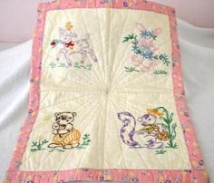 Adorable embroidered baby quilt