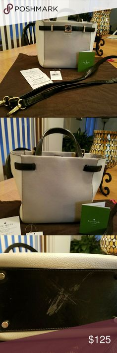 Kate Spade Leo Houston Street Leather Tote Handbag This handbag is so cute! Very modern and sure to  turn heads! It is in perfect condition, besides I scraped the bottom while carrying it and trying to push a wheelchair. The wheel scraped the bottom. Im sure it can be filled in with black marker or dye if someone wanted to.  It comes with the dustbag, gift receipt, and tag unattached. It has a strap if you want to carry it as a cross body. Every time I carry it, I get compliments. I need to…