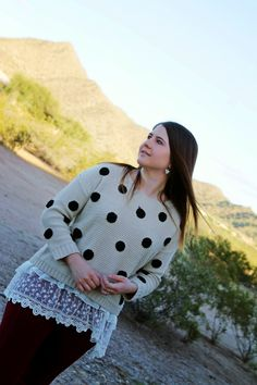frilly lace layers underneath a giant polka dot sweater.