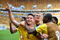 James Rodriguez of Colombia celebrates scoring his team's first goal with his teammates during the 2014 FIFA World Cup Brazil Group C match between Colombia and Cote D'Ivoire at Estadio Nacional on June 2014 in Brasilia, Brazil. Soccer Fifa, Top Soccer, Soccer News, World Cup Games, World Cup Groups, Brazil World Cup, Fifa World Cup, James Rodriguez Colombia, James Rodrigues
