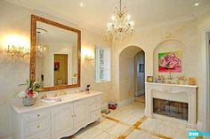 If you want a glamorous bathroom, Josh Altman has the place for you -- with a chandelier and fireplace, it really doesn't get much better.