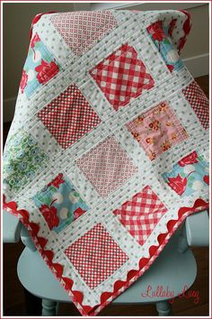 red and turquoise baby quilt, love the rickrack edge.