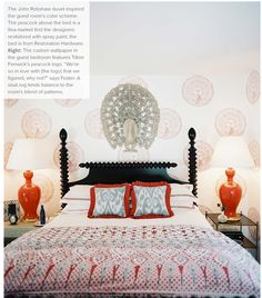 Hand-printed peacock wallpaper with john robshaw bedding orange lamps and an ebony bed. Beautiful.