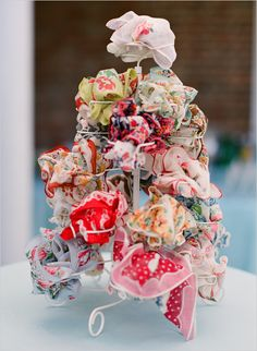 I have 2 of these wire cupcake trees, cute for vintage handkerchiefs! Need vintage hankies, find them here @ Nanalulus Linens and Handkerchiefs : http://www.nanaluluslinensandhandkerchiefs.com/Ladies_New_and_Vintage_Handkerchiefs_Hankies_s/1921.htm