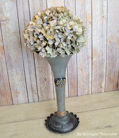 Trash to treasure vase made from a semi truck horn. From MySalvagedTreasures.com