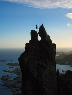 Who Dare to do this? Jump within Svolværgeita Pinnacle horns in Lofoten Island Archipelago, Norway