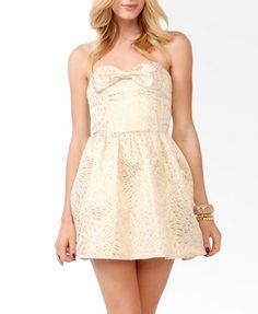 Brocade Bow Tube Dress - style it up with short pearls, gold bracelets mixed with pearl bracelets, hair tied up in a bun!! Dolled up!!
