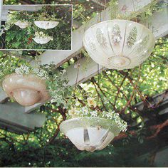Antique light fixtures repurposed as hanging flower pots.  My dad has a basement full of these.