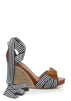 Lace-up these wedges and pair it with a crisp white blazer!