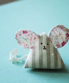 How to Make a Mouse Pincushion - sew-whats-new.com I think I'd look sad if someone was sticking me with pins too!