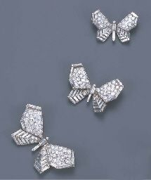 THREE ART DECO DIAMOND BUTTERFLY BROOCHES, BY BOUCHERON   Each butterfly of similar design and graduating size, with pavé-set diamond upper wings and baguette-cut diamond lower wings and body, circa 1935, 5.4, 3.9 and 3.3 cm. wide. Auctioned off by Christies of London in  their June 2002 Important Jewellery sale, for £23,900