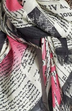 Love this 'newspaper' scarf with splashes of pink!