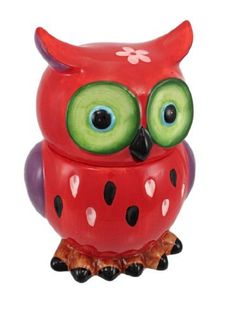 Adorable Red / Purple Owl Ceramic Cookie Jar by Things2Die4. $29.99. 8 1/2 Inches tall. Brightly Colored. Ceramic. This incredibly cute red and purple owl ceramic cookie jar really brightens up a kitchen. The owl features bright green eyes, brown feet with black talons, and has a pink flower on the top of its head. It measures 8 1/2 inches tall, 6 inches wide and 5 inches deep. It makes a great gift for owl lovers.