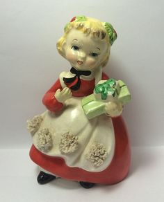 #MerryChristmas ... I'm sold!  Girl Ceramic Figurine holds Gifts Soaring Hawk Vintage Red Dress Pinafore Secret Gift Holiday Decor 1950s #Japan Holly Hair Ribbons at #SoaringHawkVintage on #Etsy #midcenturychristmas