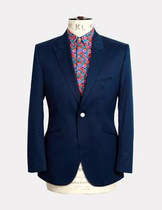 On button peak lapel jetted pocket blazer