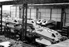 """""""MIAG factories, Braunschweig, May 1945 - thirty Jagdpanther structures and at least 6 of Stug III (and two superstructures) stored in a part of the industrial complex."""""""