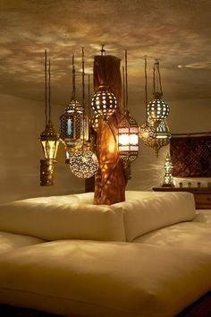 Moroccan lamps clustered in a corner #Anthropologie #PinToWin