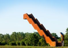 Gravity-defying staircase forms an observation tower overlooking rolling farmland in Belgium