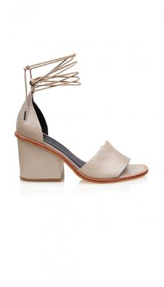 This chunky block-heel with on-trend multi-wrap ankle straps will be your go-to for the season. Offering comfort and support, the neutral color options will be the perfect finishing touch on any look. 100% Leather. Made in Brazil.    Style Number: SR115CLA5081  Available in Taupe, Navy, Black, and Burnt Orange