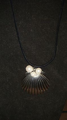 Shell pendant w/ beads on black cord necklace
