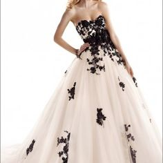 Beautiful ivory/black ball gown by Maggie Sottero. Purchase it at http://www.victoriarosebridals.com/?product=cosette  $1200
