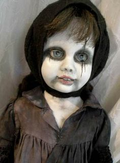 Another pinner says: Awesomely creepy doll. I followed the link and it doesnt tell you much but just the visual will give you an idea on how to take  an old ordinary doll and make it creepy. I have some on my Halloween board that I made last year and the idea came from How to Haunt your House.