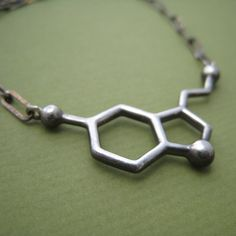 Serotonin molecule necklace by made with molecules. For happiness!