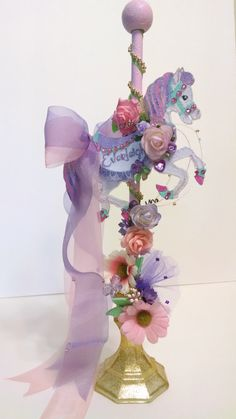 Should be easy to make.. Candle holder, spindle, carousel cut out, paint add flowers