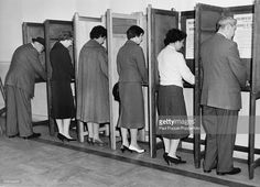 Early morning voters at the polling station in Lambeth Town Hall, London, during the General Election, 8th October 1959.