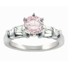 This looks like my engagement ring! My hubby knew me well...it was a pink sapphire in white gold.