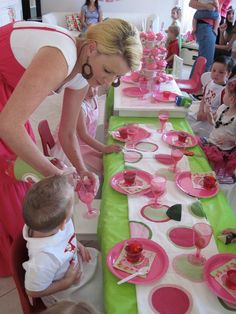 Strawberry Shortcake Tea Party -- like the green tablecloth with the runner and the pink plates, etc.  Taking note ...