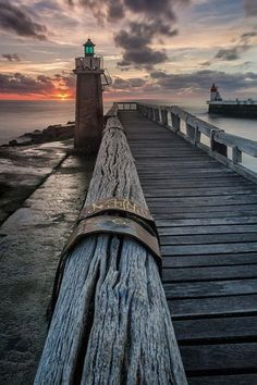 Sunset on rustic pier.